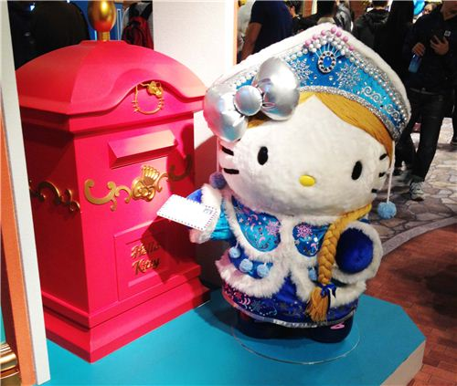 Hello Kitty as a Russian woman at the mailbox
