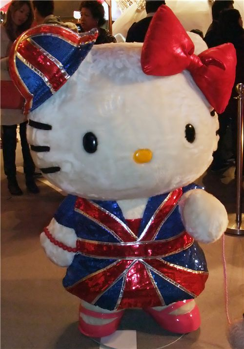 Hello Kitty wearing a sparkling England dress
