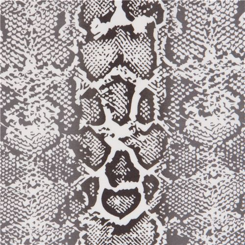 white Robert Kaufman knit fabric with snake print
