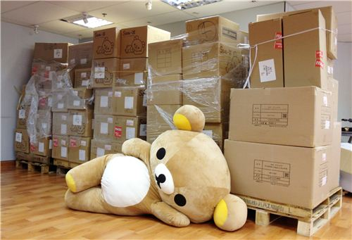 Our big office Rilakkuma lounging in front of the big delivery