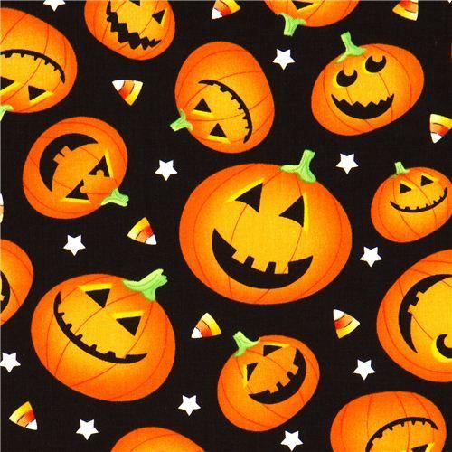 black Halloween designer fabric with orange pumpkins