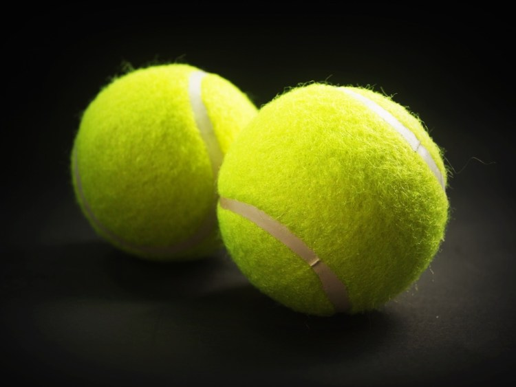 Toss tennis balls to make your laundry extra fluffy!