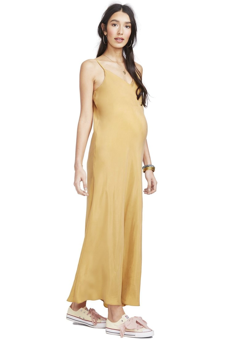 febc3da63e9f5 This slinky dress has a classic maternity photo feel thanks to its length  and soft color palette, but hits a more modern and streamlined note.
