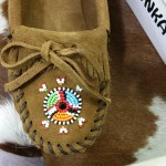 Minnetonka brown suede moccasin with tribal beaded embellisment