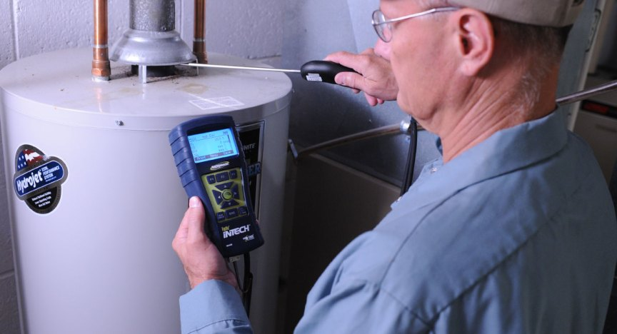HVAC technician testing residential water heater with InTech Combustion Analyzer.