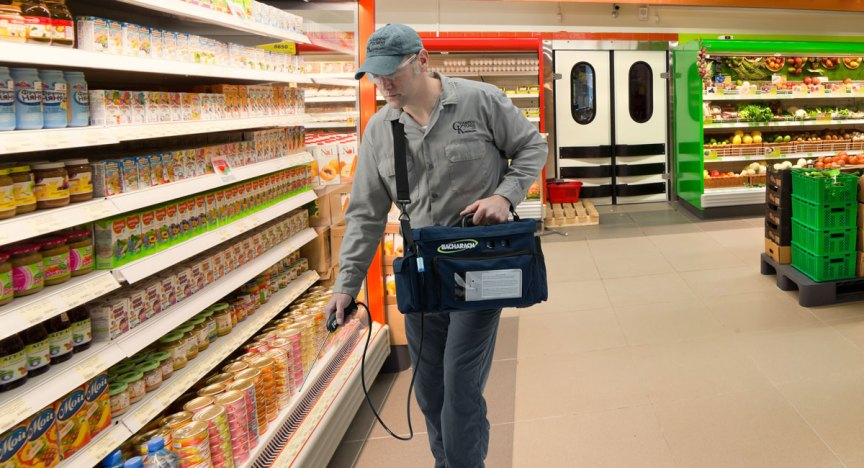 Refrigeration contractor using PGM-IR to perform a refrigerant leak inspection in a supermarket.