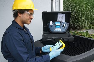 HVAC technician analyzing R-22 refrigerant from a residential air conditioner.