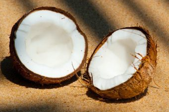 Natural coconuts on a beach