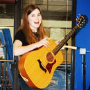 Anika on Guitar at the Boise Rock School