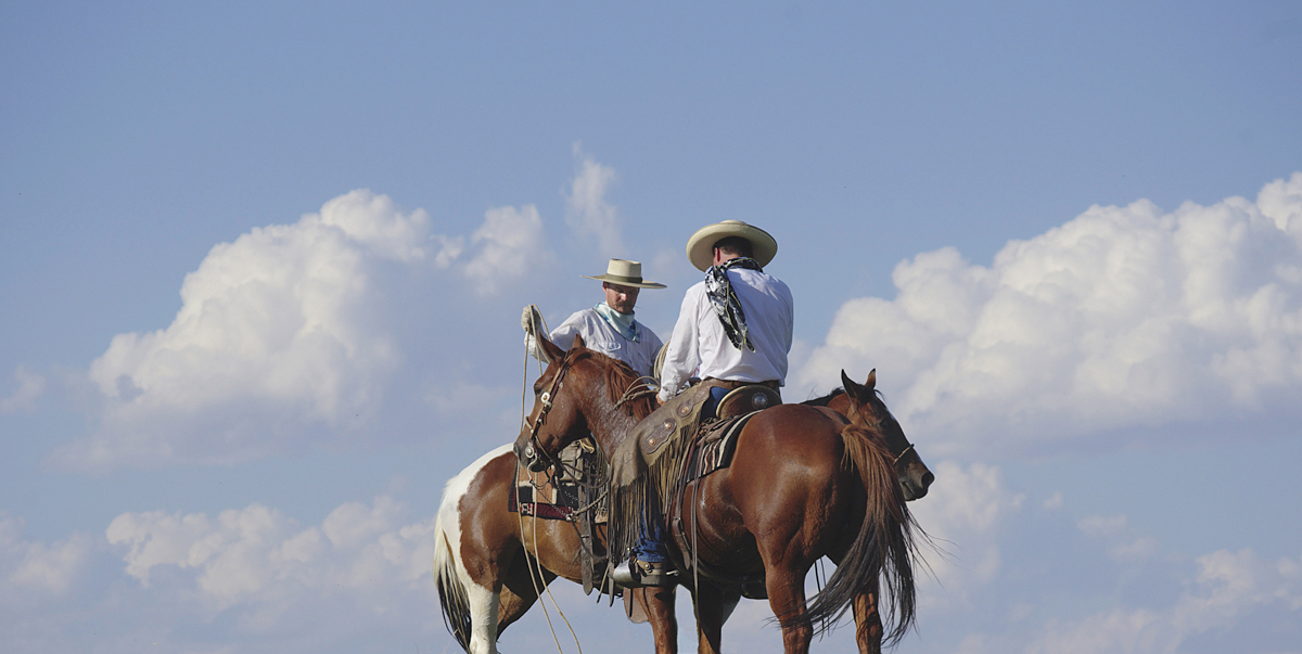 Two People on Horses