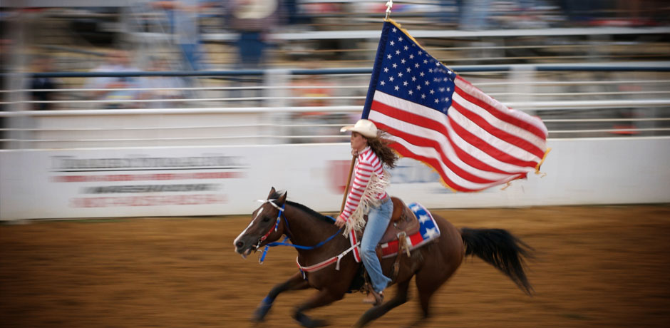 Rodeo rider and the American flag