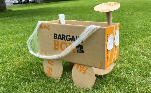 A cardboard car made from a Bargain Box