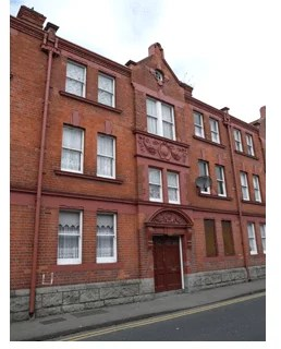 Buildings like this were built for Dublin's working class in the 19th century by the Dublin Artisan Dwellings Company, supported by the Guinness family.
