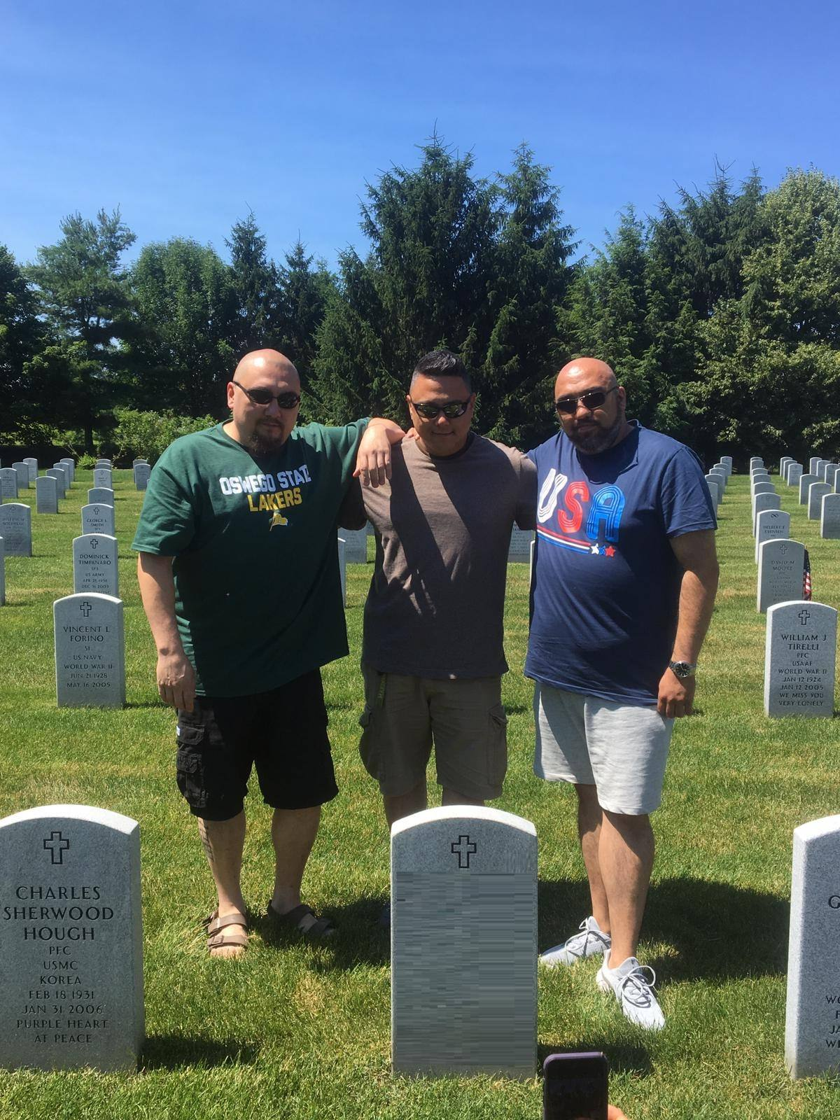Johannes and his biological brothers visit their father's grave together