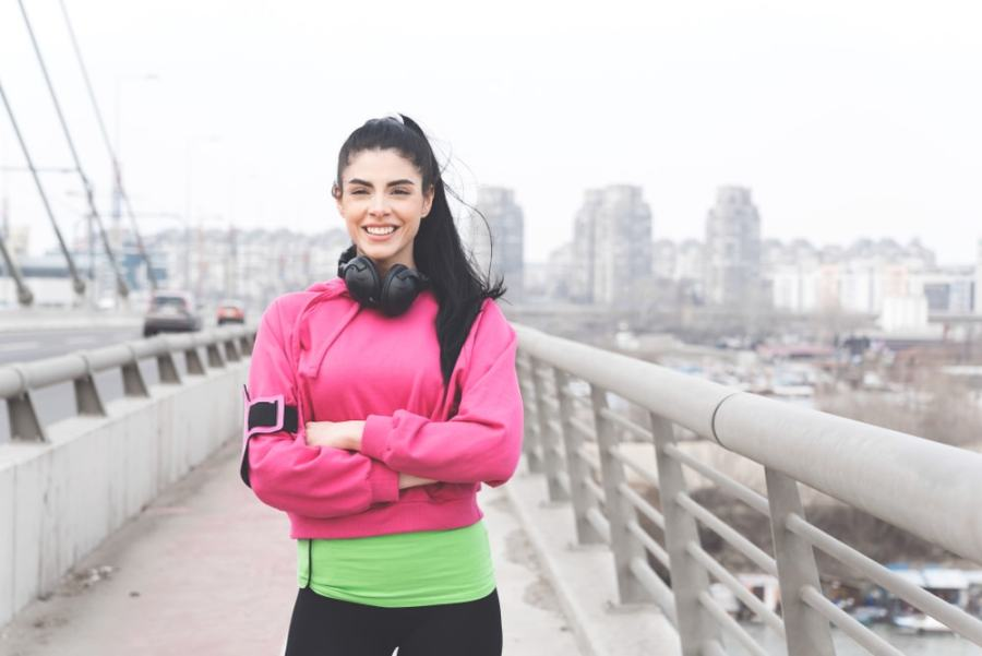 Sporty woman pausing during a walk or run