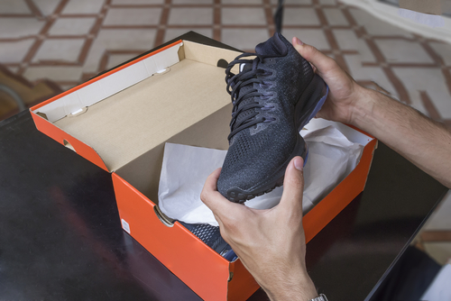 Unboxing new black walking or running shoes