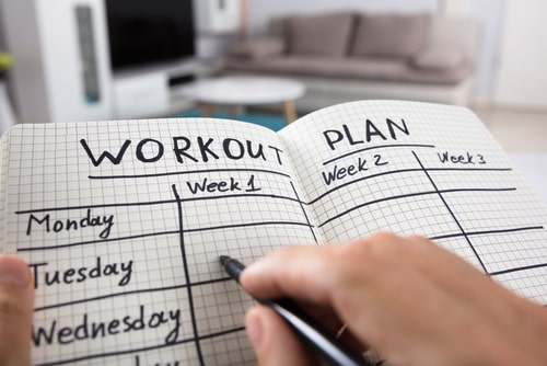 Workout plan in notebook planning concept