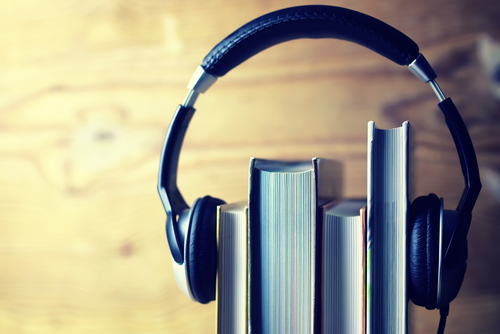 Headphones on books - listen to audiobooks concept
