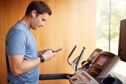 Man walking on treadmill at home
