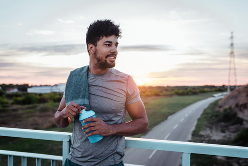Athlete drinking water after a hard jog