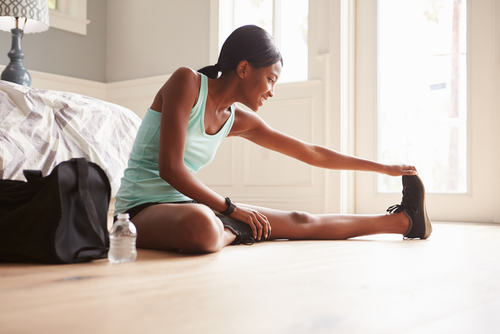 Woman stretching at home after a workout