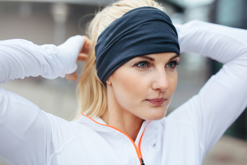 Woman tying hair ready for a walk or run
