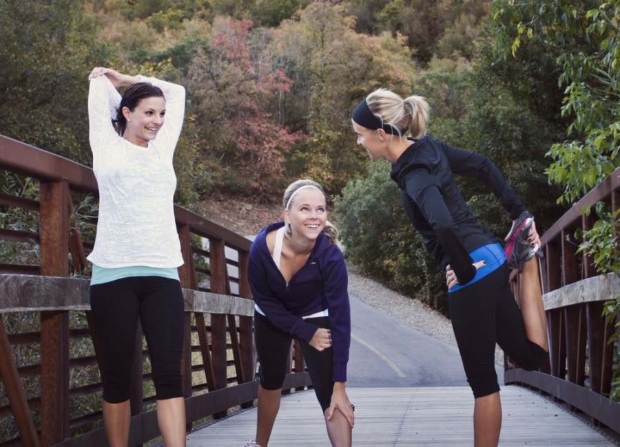 3 women stretching for an intense walk