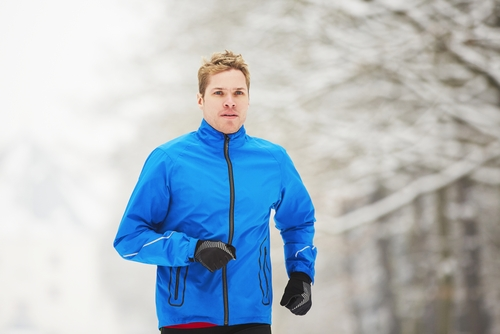 Man walking outside in winter clothes