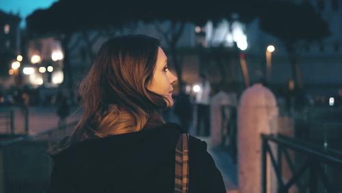 Woman walking in a dark area
