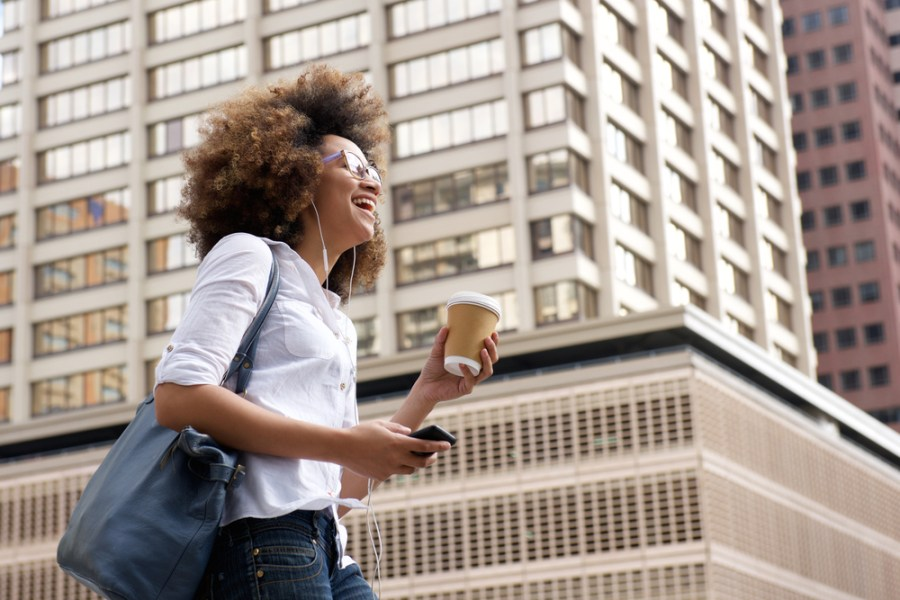 Smiling woman walking in a city environment