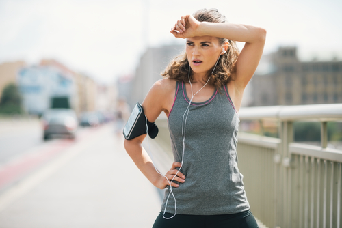 Woman jogger or walker sweating