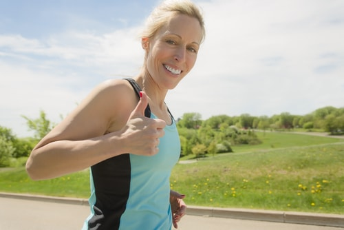 Female jogger giving thumbs up
