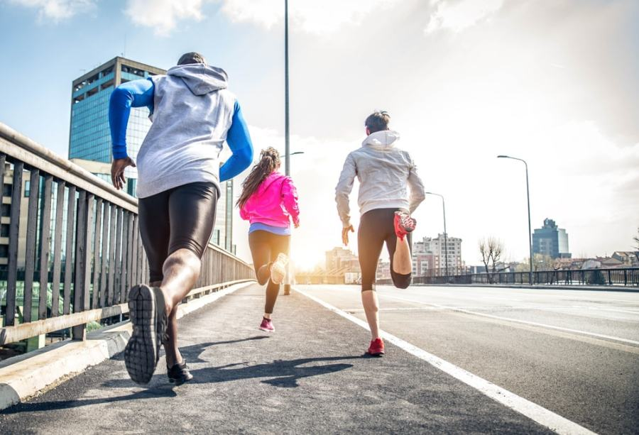 Back view of runners on a road