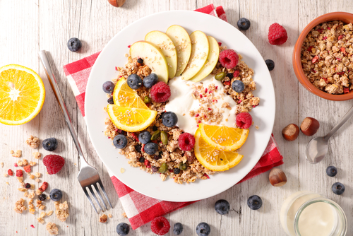 Healthy, colorful breakfast yogurt bowl and fruit
