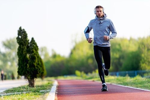 Man running on jogging path