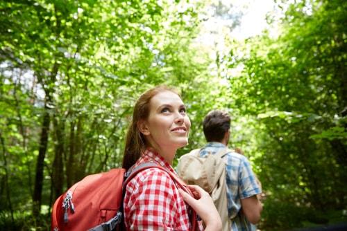 Woman feeling happy walking in nature