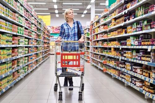 Woman walking in supermarket