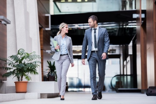 Businesspeople walking together in an office building