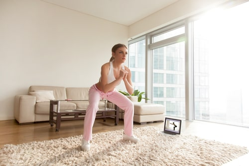 Woman doing lower body exercises at home