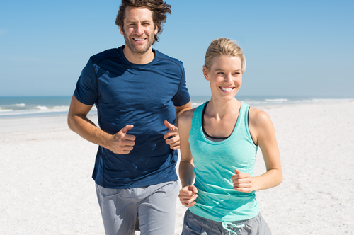 Couple walking for fitness on the beach