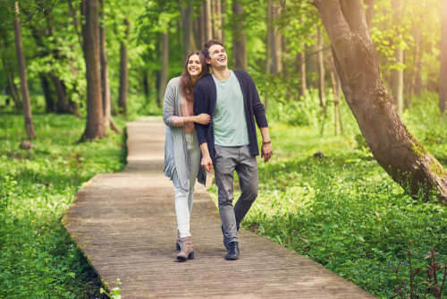 Couple walking in nature and having fun