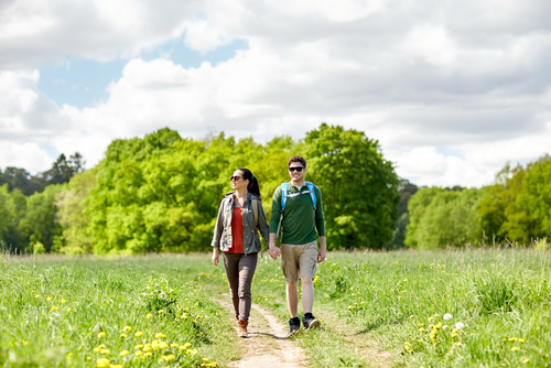 Couple walking in a wooded countryside
