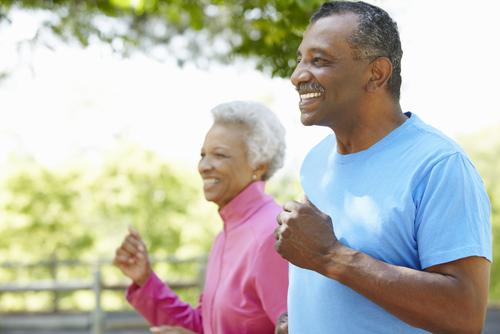 Senior couple fitness walking in the park