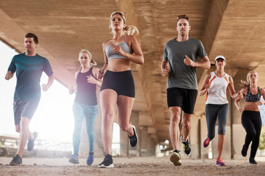 Group of people running together for fitness