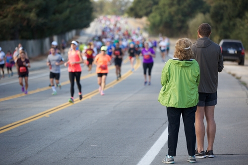 People watching a distance running race