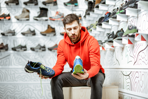 Man trying on new walking sneakers
