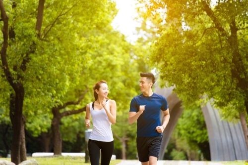 Man and woman power walking for fitness