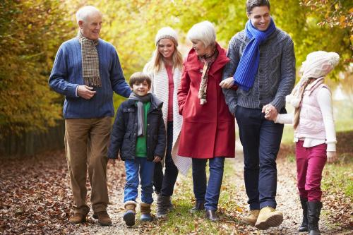 Multi-generational family walking in autumn
