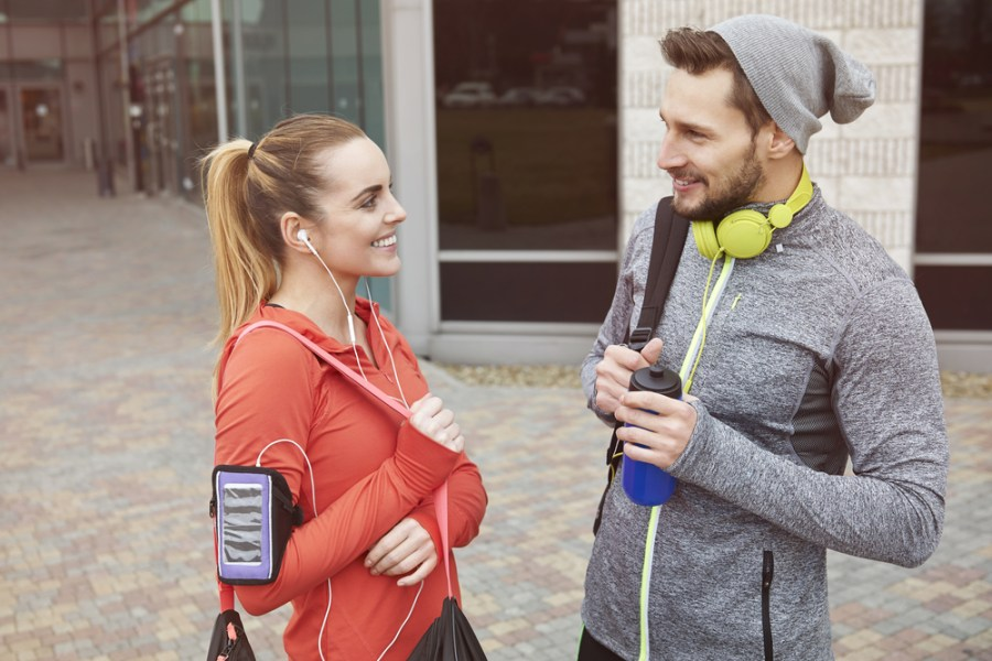 Sporty couple ready with gear for a long fitness walk