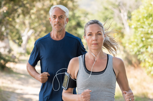 Couple on a long walk for fitness or cardio